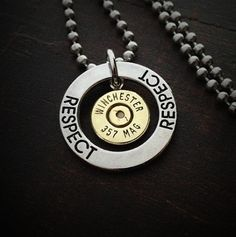 It's time to demand respect and get into the Ring of Fire Bullet Jewelry. JECTZ® ignites a Fire in this Bullet Necklace for Men. The bullet head floats in the middle of the ring on a Genuine Stainless Steel Necklace Ball Chain. Bullet Shell Jewelry, Shotgun Shell Jewelry, Bullet Casing Jewelry, Bullet Necklace, Men Necklace, Shotgun Shells, Ammo Jewelry, I Love Jewelry, Jewelry Art