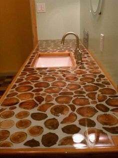 Cordwood Counters - neat idea for garden shed... forget the garden shed, this would be neat idea for a log cabin home's bathroom!