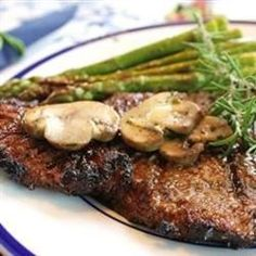 "Grilled Delmonico Steaks | ""Marinated steaks so tender you can cut with a fork! Friends and family always come running when they know I'm grilling."""