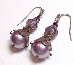 Earrings Lavender Amethyst Transparent Donut Swarovski Crystals and Pearls Filigree Antique Brass Glass Rondelle Exquisite FREE SHIPPING. $6.95, via Etsy.