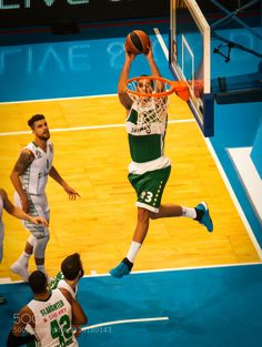 71d1a1c8024 Pavlovic of Panathinaikos Athens catches an alley-oop pass from Nick  Calathes for a dunk in a Euroleague basketball game