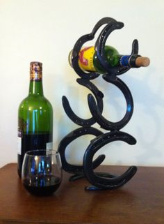 Abstract 3 tier horse shoe wine rack with by TwistedVinesForgeArt, $50.00