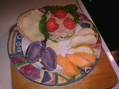 Anorher healthy Organic homemade  meal- pure tuna fish on pita bread, top with organic plum tomatoes, served with a side of Organic purple potatoes, along with slices of fresh pair an fresh cantaloupe. Whole Foods Market, does a body great!
