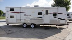 26ft - 2010 - Zinger by Crossroads - $13995.00 Zing a Ding Ding! This one will make your head ring it is so fine! This stunning 2010 bumper pull  by Cross Roads Rv is perfect for the family summer fun vacations! It is 26 ft of half-ton towable fun and adventure! With sleeping for up to 8 the whole family will be creating cherished memories that will last a life time in this fun travel trailer! Call Bob Barker @469-554-0440 & lets make a DEAL! See more travel trailers @ BudgetRVsOfTexas.com