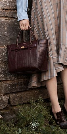 Shop the Small Zipped Bayswater in Oxblood Deep Embossed Croc Leather at Mulberry.com. The Bayswater is our most iconic bag, and its eponymous collection includes new styles inspired by the original. The Small Zipped Bayswater is the perfect option for those who like a zipped closure. Using the same construction as a Bayswater, this new style plays with the detail - deconstructing the front by removing the flap and using the iconic postman's lock to secure two belted straps.