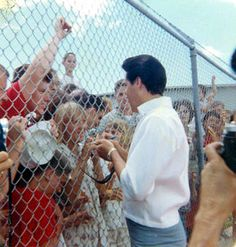 On August 15,1965, Elvis, Vernon and the Colonel visited the USS Arizona in Hawaii, here with fans.