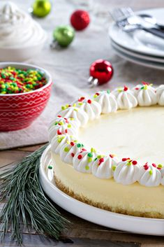 Sugar Cookie Cheesecake is baked up with every kind of sugar cookie goodness you could imagine. It's sweet, festive and perfect for the holidays!