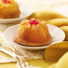 Mini Pineapple Upside-Down Cakes Recipe from Taste of Home -- These individual pineapple upside-down cakes are an eye-catching addition to any holiday dessert table!
