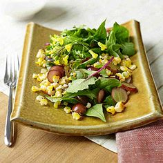 Mexican Roasted Corn Salad With Buttermilk Dressing:  Blend Mexican and Mediterranean ingredients with the fresh-tasting salad. Corn, lime, and chili powder, combined with grape halves and Parmesan, make a flavor-packed feast for a little over 200 calories. | Health.com