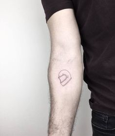 Simple Helmet Tattoo on Inner Forearm