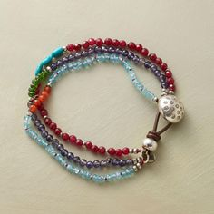 """CHLOE BRACELET--Overlapping strands create an interplay of smooth blue iolites, apatite rondelles, faceted red jade, chrome dioxide, carnelian and turquoise beads. Each strand with a contrasting centerpiece. Leather and sterling silver button clasp. Handmade exclusive. 7-1/4""""L."""