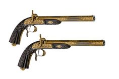 A FRENCH CASED PAIR OF RIFLED PERCUSSION PISTOLS OF PRESENTATION QUALITY, DECORATED WITH ELABORATE GOLD-ENCRUSTED VINE PATTERNS, BY LOUIS-FRANCOIS DEVISME à PARIS, dated 1852.