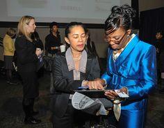 Women's Business Development Director Carol Bell (right)