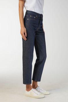 Model side image of Arket fitted rigid denim jeans in blue