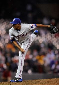 MINNEAPOLIS, MN - APRIL 13: Alexi Ogando #41 of the Texas Rangers delivers a pitch against the Minnesota Twins during the ninth inning on April 13, 2012 at Target Field in Minneapolis, Minnesota. The Rangers defeated the Twins 4-1. (Photo by Hannah Foslien/Getty Images)  game 8