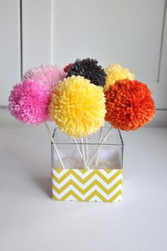 Yarn Pom Pom Bouquets (Tutorial)  I used to make tons of these when I was a kid!! I like the ruler method!
