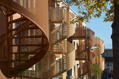 Colourful spiral staircases now give direct access to units in the Saint-Michel Nord housing complex in Montreal, which was renovated by Saia Barbarese Topouzanov to update the ageing buildings and include a new pedestrian-friendly street.