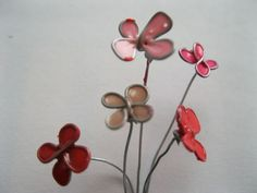 """""""Stained Glass"""" flowers made with 26 gauge wire and nail polish. Looks easy enough for us to do. Love their idea of turning them into rings."""
