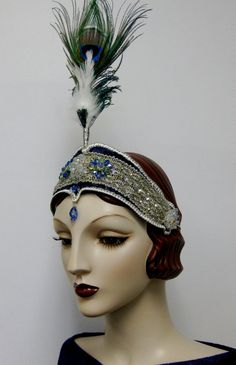 1920's accessory: This headache band is a style of headband. Some were jeweled and others with tall feathers like the one seen here were popular for evening wear.