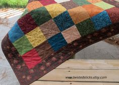 Autumn Patchwork table runner, Scrappy table runner, warm color palette. $52.00, via Etsy.