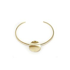 A favourite statement piece from our collection. The Isabelle choker features a high shine circle with riveted wave. By Wolf Circus 14k gold plated...