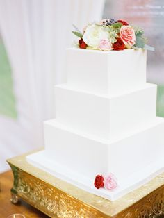 Stunning white square cake with fresh flowers Repinned by Every Bloomin' Thing #IowaCityFlorist #IowaCityWedding