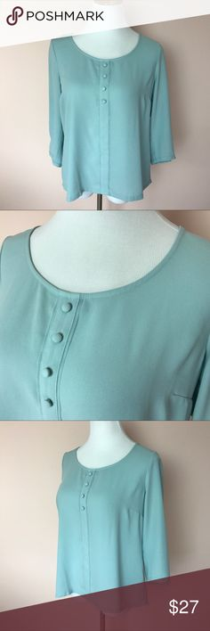 "LC Lauren Conrad Light Blue Top Size Medium This listing is for an LC Lauren Conrad 3/4 Sleeve Blue Top in a Size medium.  •3/4 Sleeve, slip on styling  •100% polyester  •machine wash cold inside out, dry flat •armpit to armpit 20"" •length 22.5"" •Top modeled on a Size 6/8 dress form  Top will be delivered gently steamed & beautifully wrapped in tissue.  🍑We strive to ship out the same day if ordered before noon and the next day if after.  Follow us on Instagram @peachesandking 🍑  🛍Bundle…"