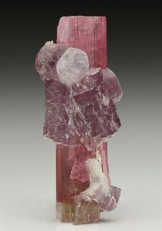 A fine gemmy pink single crystal of Tourmaline from California's most well-known Gem Pegmatite at the Himalaya Mine, San Diego County. Crystal Classics Minerals