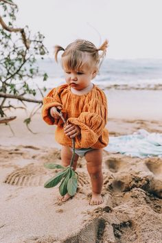 OMG, this looks exactly like a picture taken of me in 1971, taken in Gibralter. Same bunches, same face, same chubby knees https://presentbaby.com