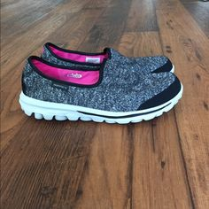 Gray & black Go Walk Sketchers. Worn a few times Sketchers Go Walk slip on sneakers. Gray & black w/ white (very clean) sole. Worn a few times but in like new condition still! Skechers Shoes Sneakers