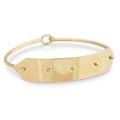 LARISA LAIVINS /18K gold rivet bangle.