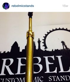 Custom mic stand - Rebel Straight Up custom mic stand with 24 carat gold plated clutch and top tube with gold holographic metal flake custom paint finish for Taylor Swift 1989 Tour www.rebelmicstands.com