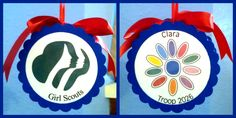 Ornaments for our Daisies - empty cardboard ribbon spools decorated with laminated printouts of GSUSA logo on one side and Daisy petals with name and troop on the other.