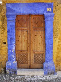 Wood doors with blue entryway. From Rhodes, Greece Old Doors, Windows And Doors, Old Town Rhodes, Portal, Greece Rhodes, Building A Door, Purple Door, Grades, Vintage Doors