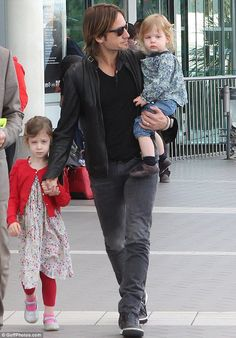 Keith Urban and his girls, Sunday and Faith.
