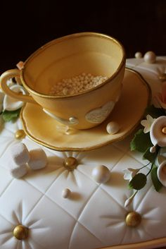 Gum paste tea cup and saucer by Andrea's SweetCakes, via Flickr
