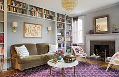Hranowsky made the living room more family friendly by adding built-in bookshelves around the sofa. Comfortable seating abounds with a pair of chairs near the fireplace and a daybed (not pictured) for lounging and reading.