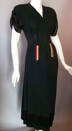 Black crepe rayon 40s dress with wide satin band at hem ad ruched satin sleeves...bright chartreuse green and fuschia pink detail at hips.