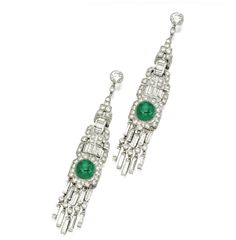 Pair of 18kt white gold,  emerald and diamond pendant earrings. Composed  of  articulated  geometric  links  set  with  round  &  baguette  diamonds  weighing  approximately  4.75  carats,  accented  by  cabochon  emeralds  weighing  approximately  4.00  carats.  http://www.sothebys.com/en/catalogues/ecatalogue.html/2010/jewels-from-the-estate-of-william-b-dietrich-sold-to-benefit-the-william-b-dietrich-foundation-n08713#/r=/en/ecat.fhtml.N08713.html+r.m=/en/ecat.lot.N08713.html/13/