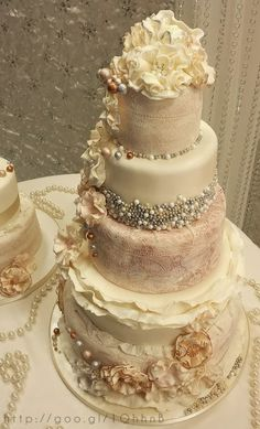 Luxurious vintage fairytale wedding cake!  Glorious beading and textured buttercream details make this cake a showstopper. Enjoy RUSHWORLD boards, WEDDING CAKES WE DO, FANCY DESSERT RECIPES and UNPREDICTABLE WOMEN HAUTE COUTURE. Follow RUSHWORLD on Pinterest! New content daily, always something you'll love!