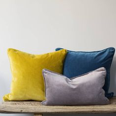 Velvet cushions add warmth and texture to a room, and these are washed to give a gently antiqued look and feel. The cushions have a piped edge in the same velve