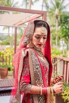 Real Indian Weddings - Sital and Sunny | WedMeGood | Beautiful Bride Sital in a Heavy Embroidered Anarkali With Mirror Work Border on Dupatta  #wedmegood #realwedding #red #mirrorwork