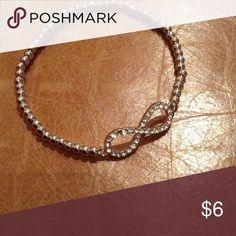 Eternal Horizontal 8 bracelet NWOT Silver tone Eternal horizontal 8 stretch bracelet. Stretches to fit all. Brand new never used. Eternal 8 Jewelry Bracelets