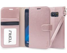 Galaxy S7 Edge Case, TORU [Prestizio][Pink] S7 Edge Wallet Case with [CARD SLOT][ID HOLDER][KICKSTAND][WRIST STRAP] - Premium Wristlet Leather Flip Cover for Samsung Galaxy S 7 Edge - Rose Gold. Fits the Samsung Galaxy S7 edge. Italian style synthetic leather folio with semi-transparent shell. 2 slots, 1 ID slot, and inner pocket to conveniently store your cards and cash. Folds into a kickstand to comfortably watch videos or browse the web. The slot on the front cover lets you call with…