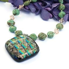 Full of colorful glowing goodness, the MAGICAL necklace is well named and definitely catches the eye!  The #handmade necklace features a stunning artisan made, one of a kind, dichroic glass pendant - by @shadowdog of Shadow Dog Designs Jewelry on Artfire