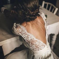 Loving the V shape on the back of lace this wedding dress. The braided updo is the perfect compliment and giving so much 2018 wedding inspiration!