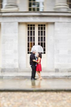 Downtown Philadelphia engagement session in the rain at the Merchant Exchange Building near Penn's Landing. Pennsylvania Wedding Photographer | Ashley Gerrity Photography