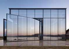 Korean studio Platform_a has completed a cafe with pivoting mirrored-glass doors and volcanic stone walls on Jeju