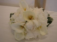 White peonies and calla lilly brides bouquet.