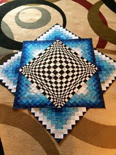 About 1/2 way done! Pattern called Convex Illusions by Kathleen Andrews!